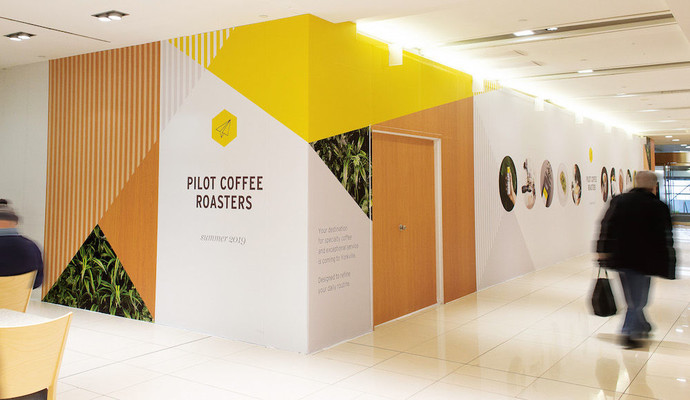 Pilot Coffee Roasters advertisement wall in the Manulife Financial Building in Toronto.
