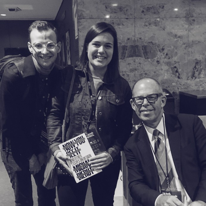 Paul Twa, Rachel Lenihan and Michael Bierut posing for a photo at a book signing.