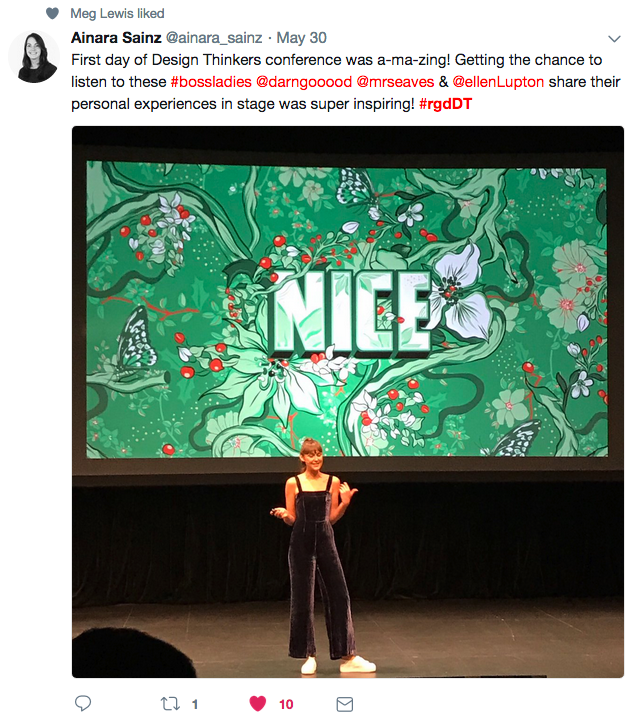 A tweet with a photo of a woman on a stage with a screen behind her. The screen has a green, flowery image on it and the word Nice is in the middle.