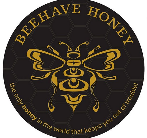 A black circle with a bee inside and inside the black circle, around the bee, it says Beehave Honey, the only honey in the world that keeps you out of trouble!