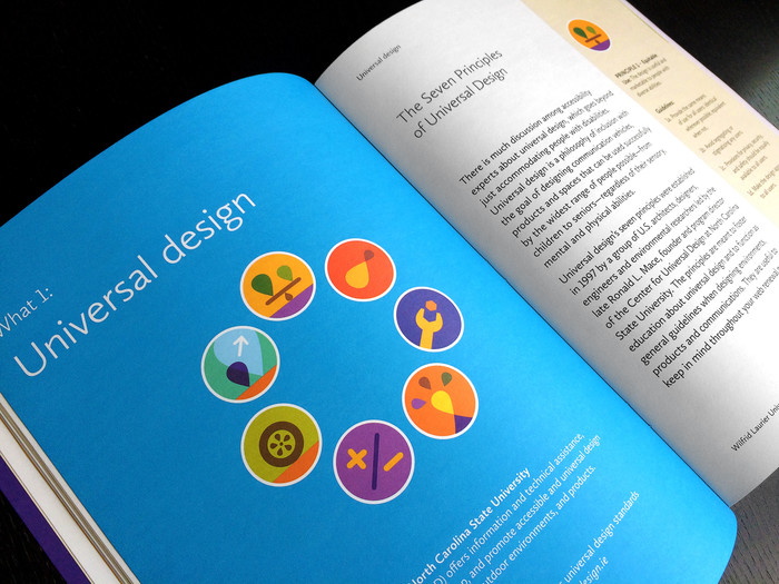 "Open handbook. The book is open to a page with the headline ""Universal design""."